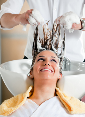 Woman getting her hair shampooed
